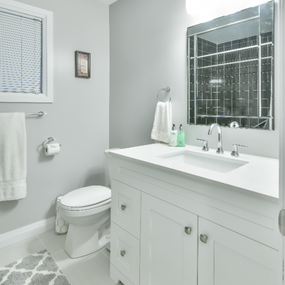 White bathroom vanity and toilet renovation